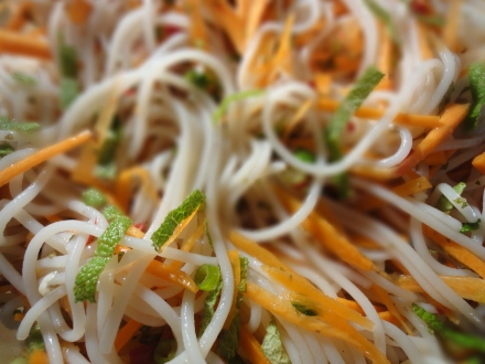 Chilled noodle salad with carrots, fresh mint, spring onions in a tangy Thai style dressing
