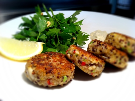 Red and white quinoa fish cakes with tilapia, parsley salad and tartare sauce