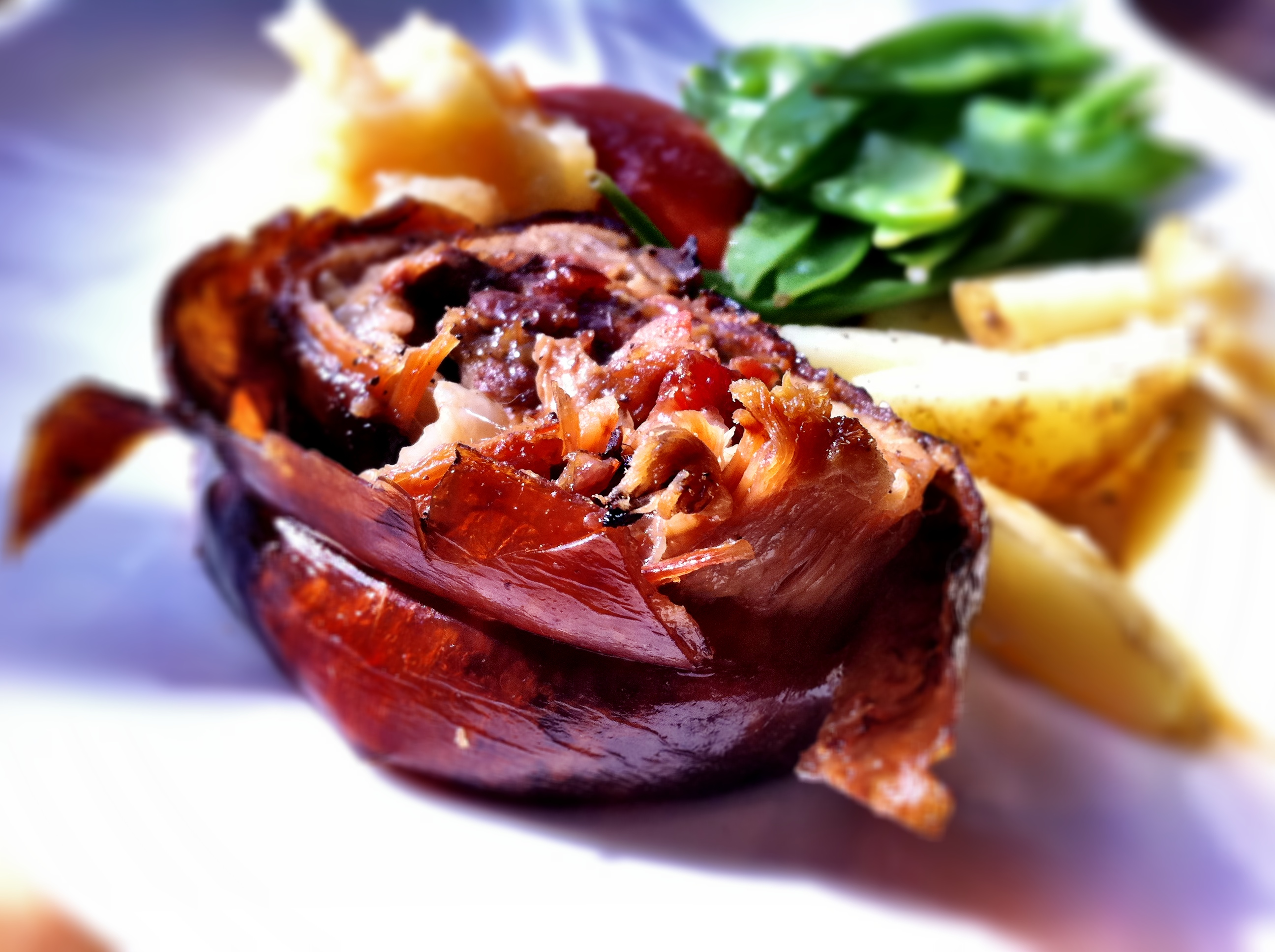 slow cooked rolled roast pork with a sage bacon and