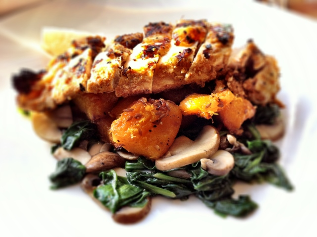 Yoghurt-spiced grilled chicken with cumin-roasted squash on a bed of ...