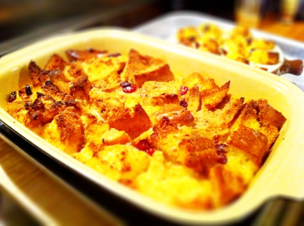 A bread and butter pudding made with cranberries and lemon zest