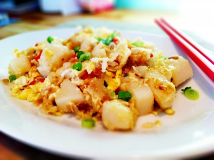 My savoury white carrot cake - fried with pink pickled ginger, eggs, garlic and spring onions. Do go to your Chinese grocery shop to try and find the traditional pickled turnips/radish though - it's really the traditional ingredients that you fry with the carrot cake.