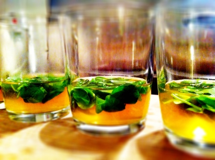 Pea shoots set in tomato jelly.