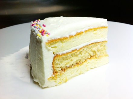 The top and bottom layers are made with Japanese cheesecake. The middle layer is a light vanilla sponge. They're all joined together and covered in a light, lemony whipped cream frosting.
